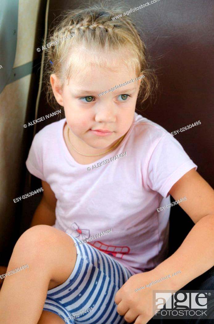 Stock Photo: four-year girl sits on a chair in the electric train.