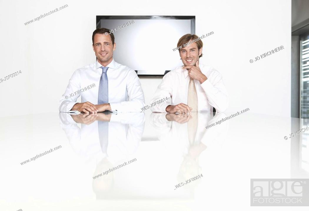 Stock Photo: Germany, Cologne, Businessmen sitting in conference room.