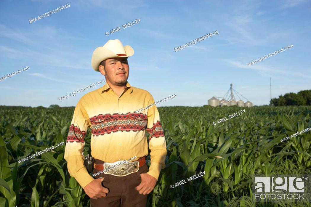 Stock Photo: Cowboy in farm field.