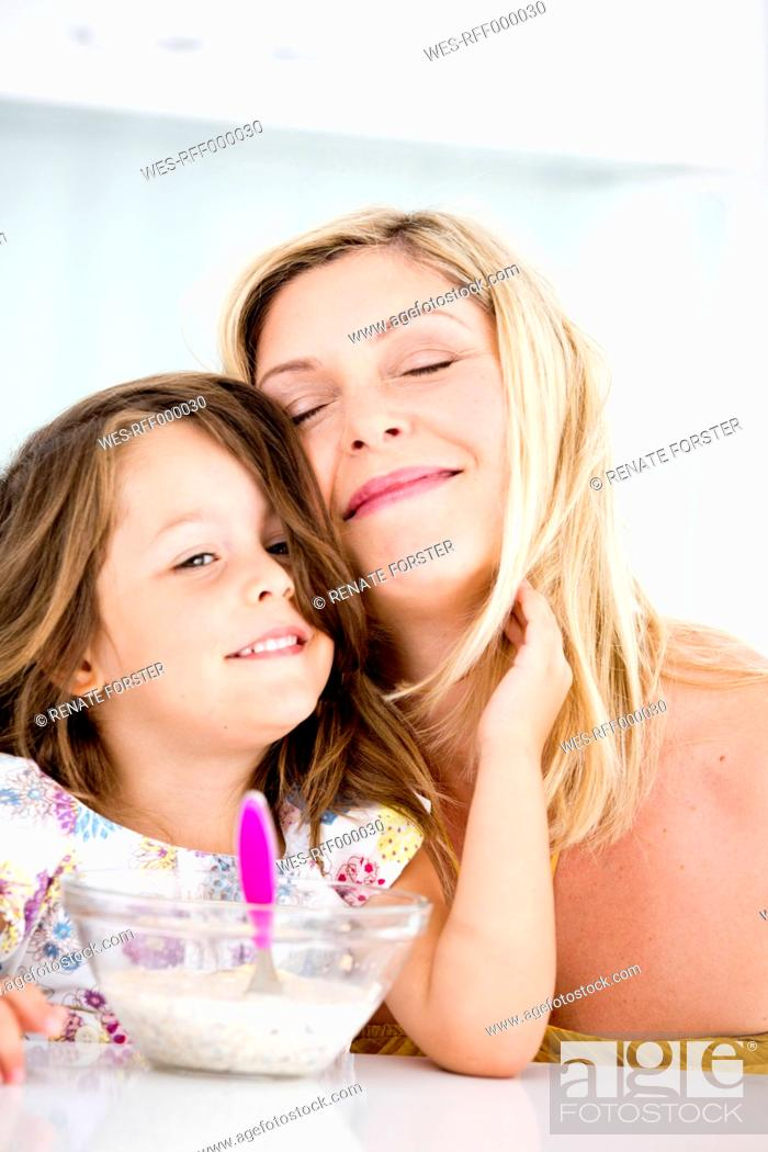 Stock Photo: Germany, Daughter touching mother, smiling.