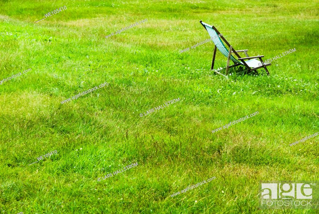 Stock Photo: Empty Deck Chair on lawn, Sweden.