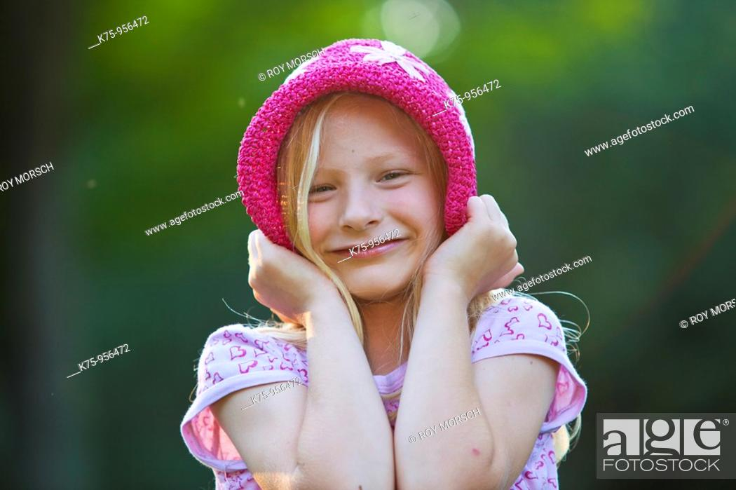 Stock Photo: Smiling girl with hat.