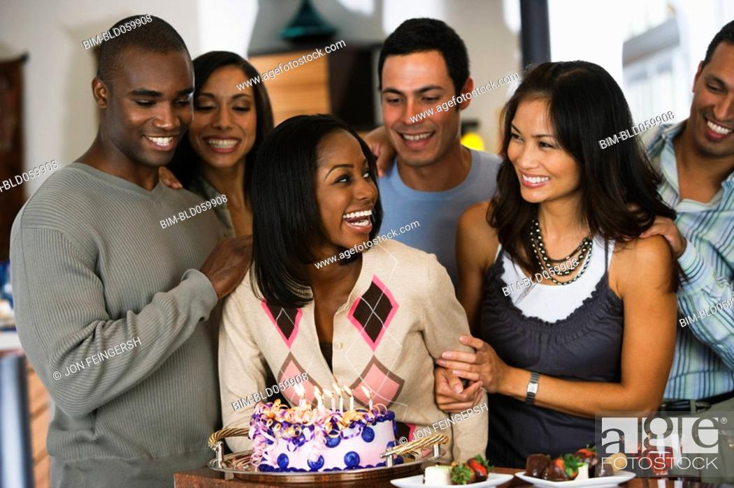 Stock Photo: African woman celebrating birthday with multi-ethnic friends.