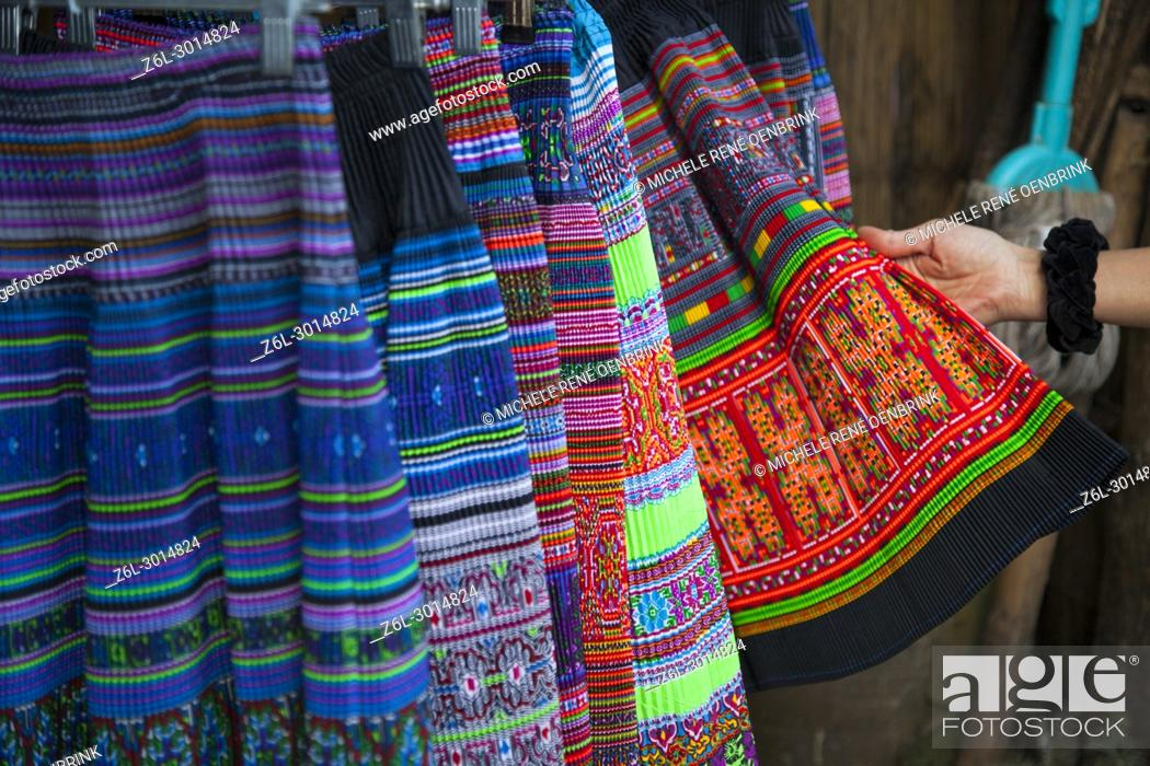 Stock Photo: tourist shopping for traditional hmong clothing at a store in Sapa Vietnam.