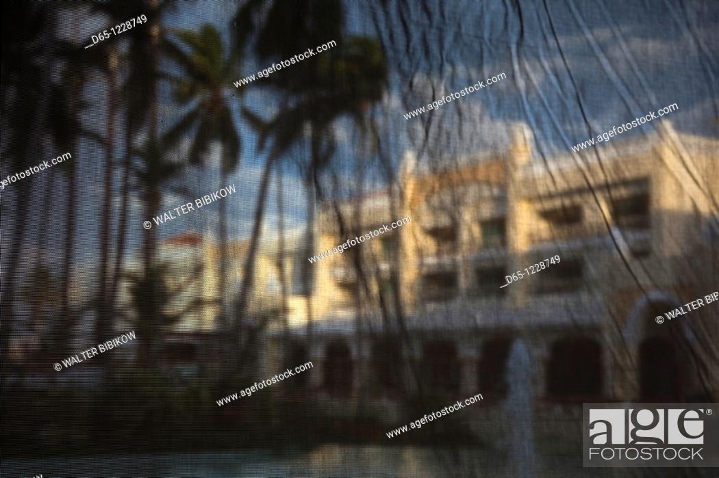 Stock Photo: Dominican Republic, Punta Cana Region, Bavaro, Iberostar Grand Hotel, viewed through mesh curtains.