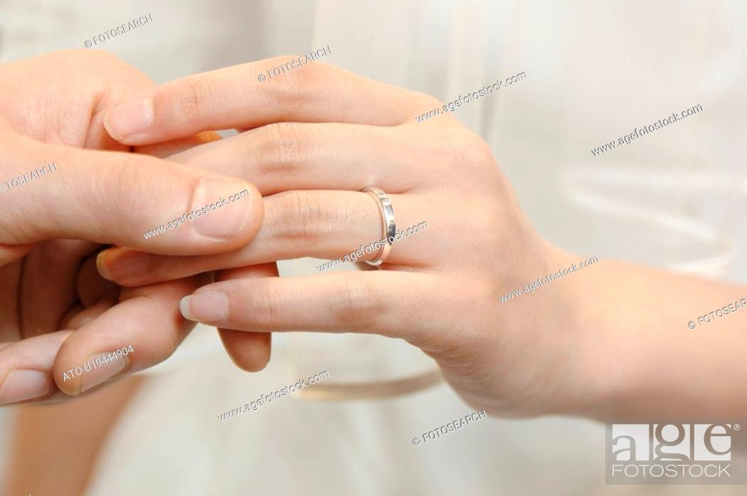 Stock Photo: Exchange of the ring.