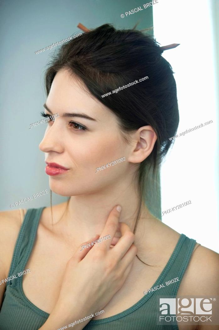 Stock Photo: Close-up of a woman thinking.