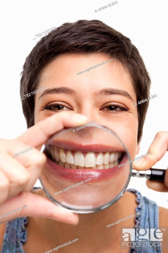 Stock Photo: Woman holding magnifying glass.