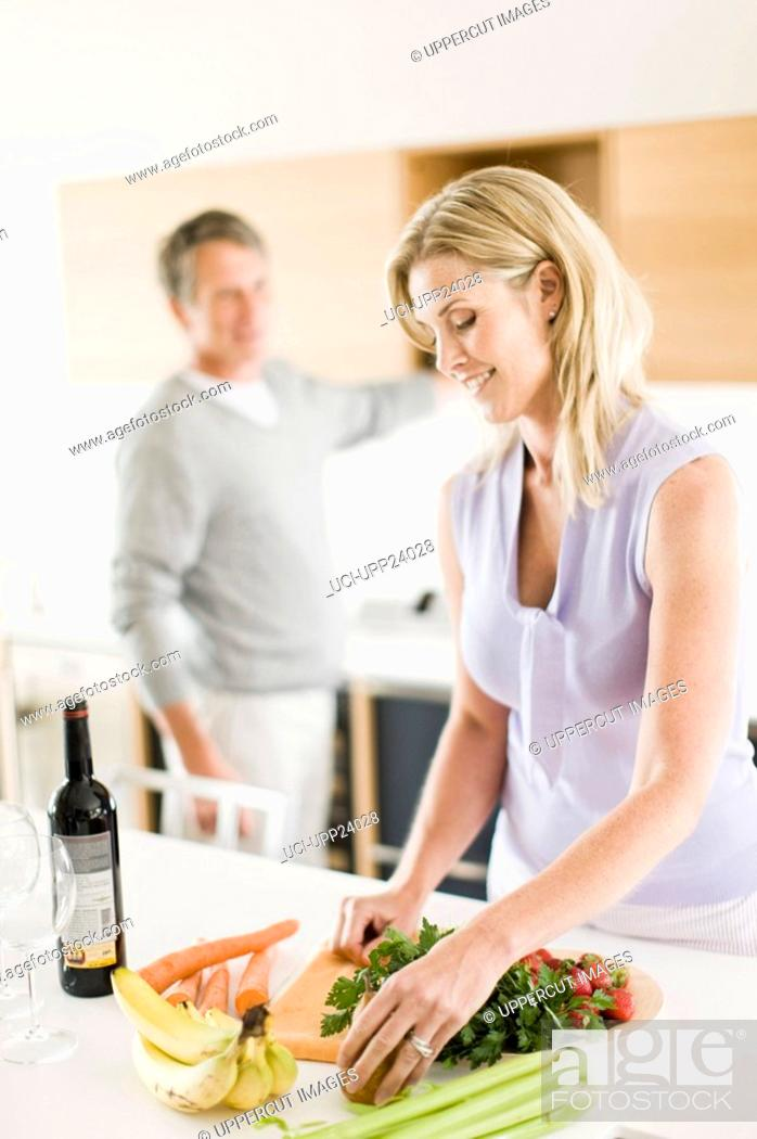 Stock Photo: Couple cooking in kitchen.