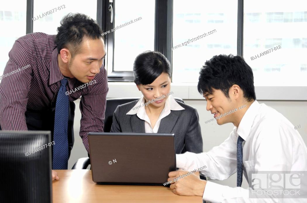 Stock Photo: Business executives discussing in a business meeting.