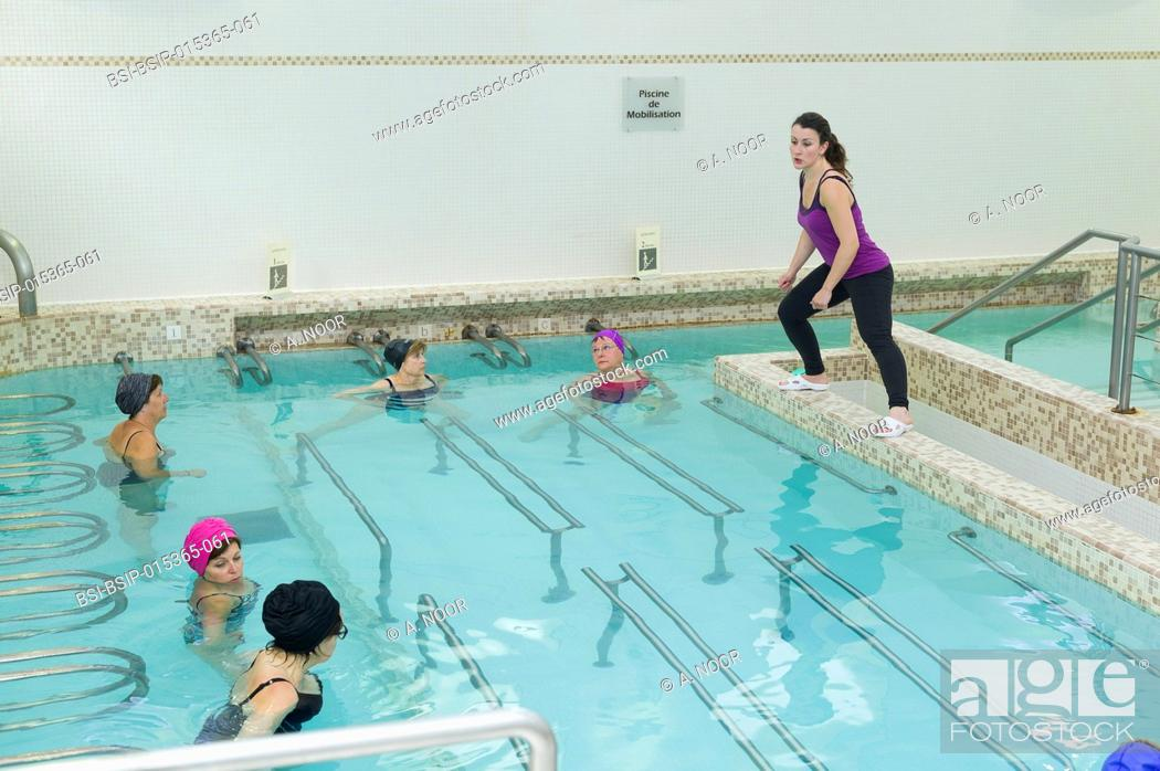 Stock Photo: Reportage at the thermal baths in Lamalou-les-Bains, France. Rhumatology treatment. Aquagym lessons for a group of women suffering from fibromyalgia.