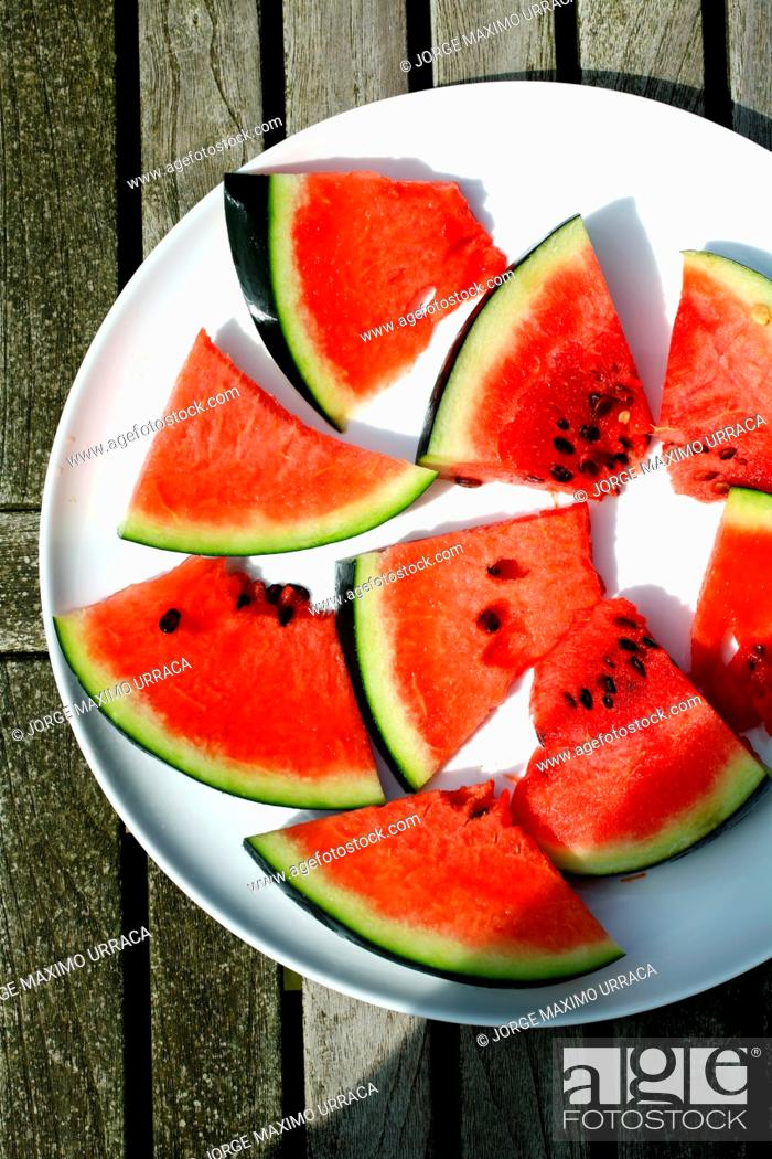 Photo de stock: Watermelon plate on wooden table.