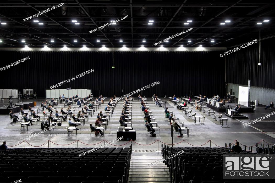 Stock Photo: 13 May 2020, Bremen: Members of the Bremen citizenry sit at a safe distance in the Stadthalle. In view of the burdens of the Corona crisis.