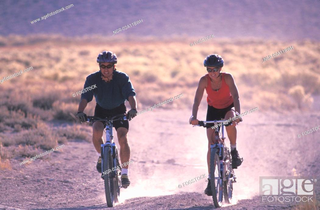 Stock Photo: Couple Mountain Biking Together.