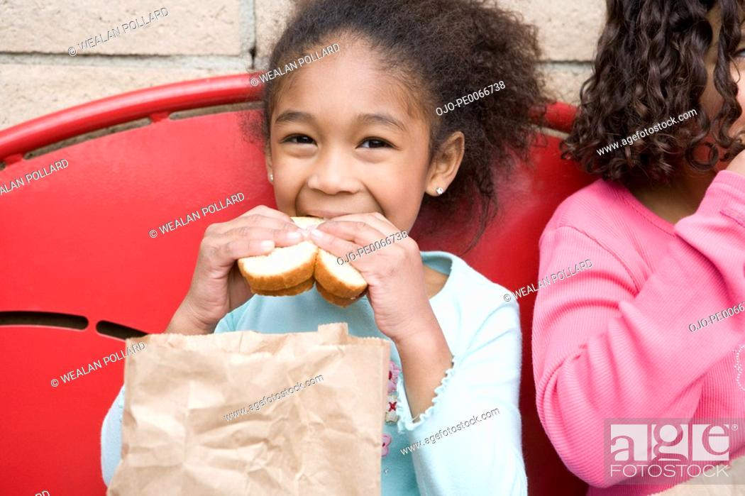 Stock Photo: Girl eating lunch at recess.