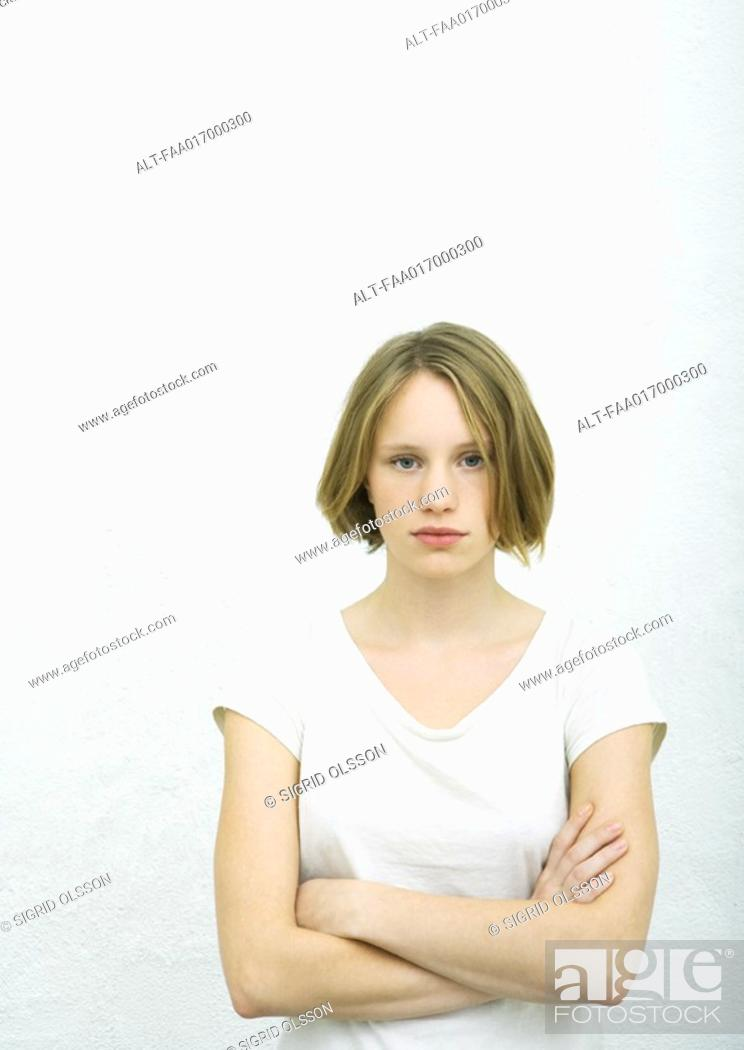 Teenage Girl Standing With Arms Crossed Portrait Stock