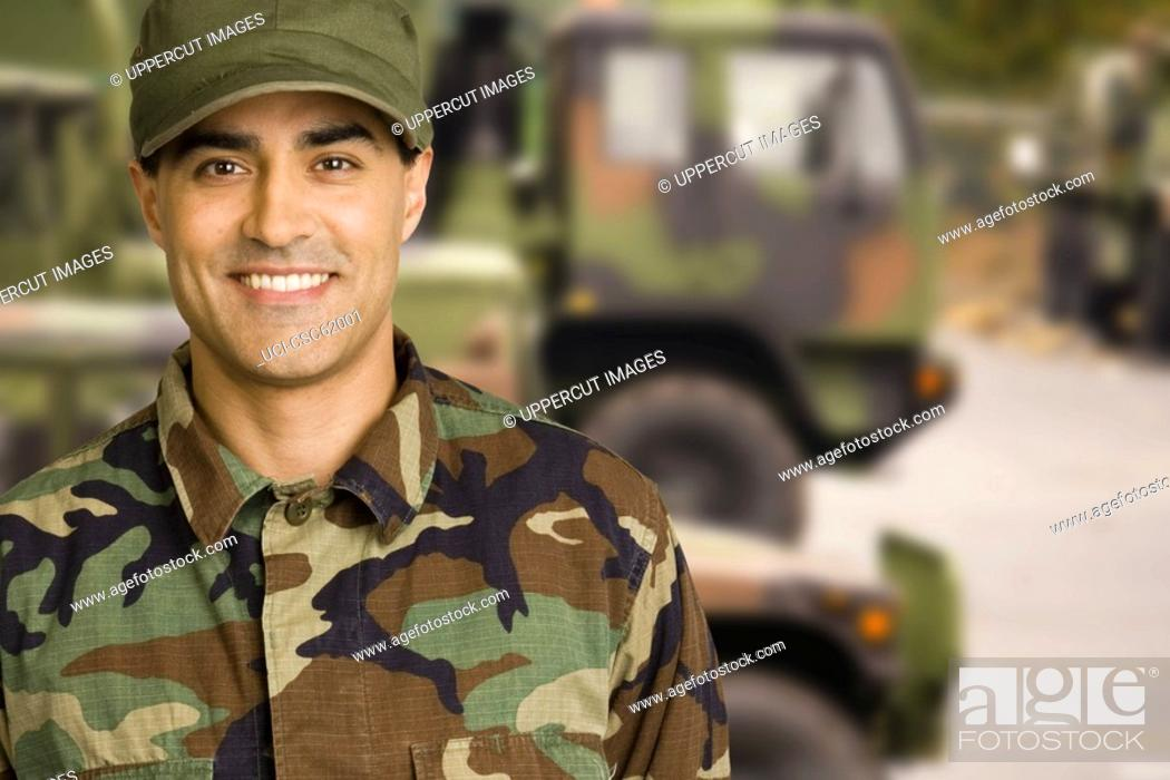 Stock Photo: Male soldier wearing camouflage.