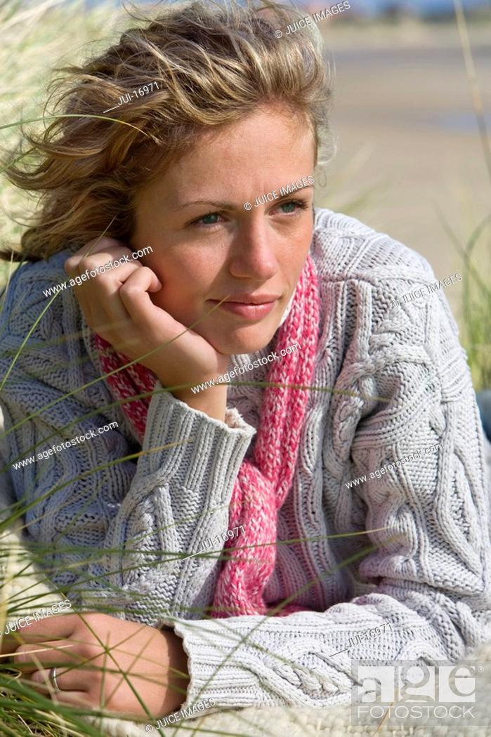 Stock Photo: Close-up of young woman lying on beach.