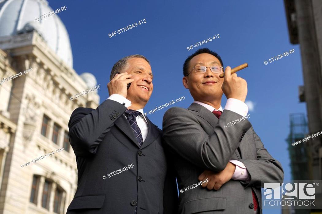 Stock Photo: Two satisfied businessman.