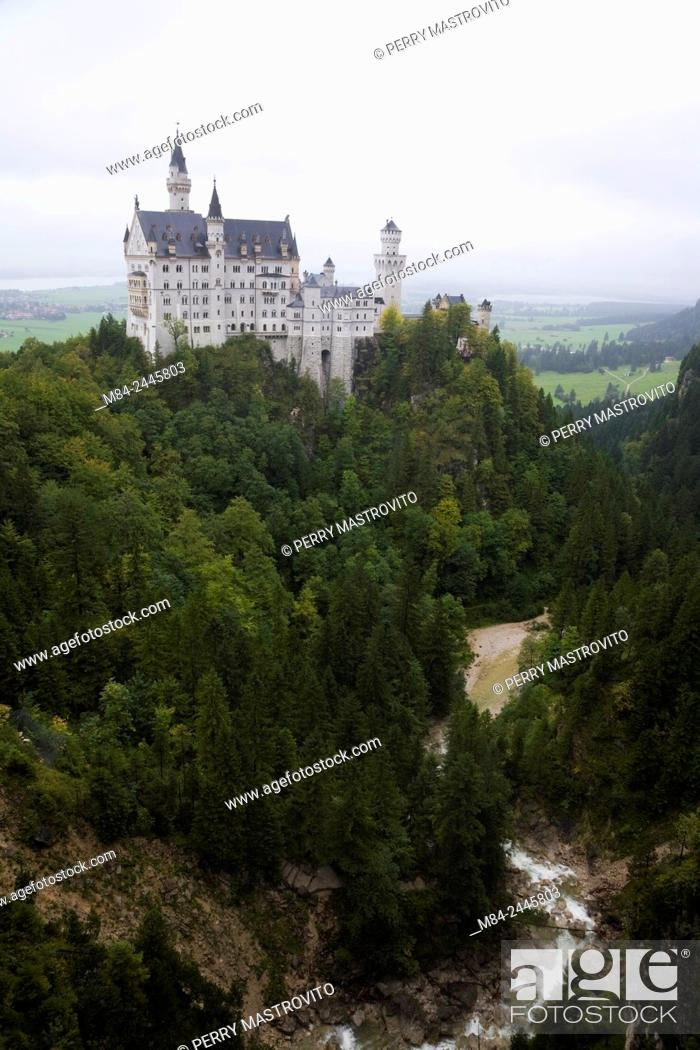 Stock Photo: Neuschwanstein Castle built in the Romanesque Revival architectural style by King Ludwig II, Hohenschwangau, Bavaria, Germany.