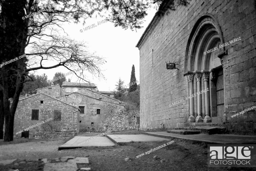 Stock Photo: Church of Santa Maria main door dating 12-13th century, built in Romanesque style. Siurana. Tarragona province, Spain.