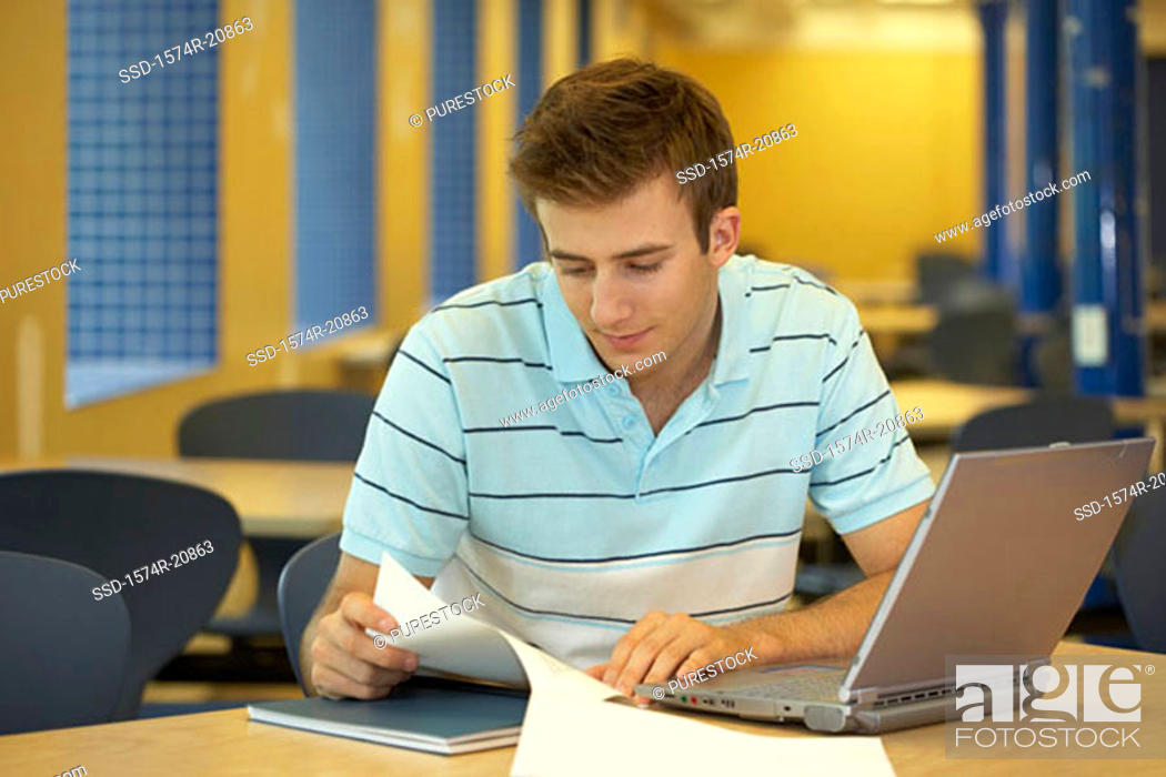 Stock Photo: Close-up of a college student reading a paper.