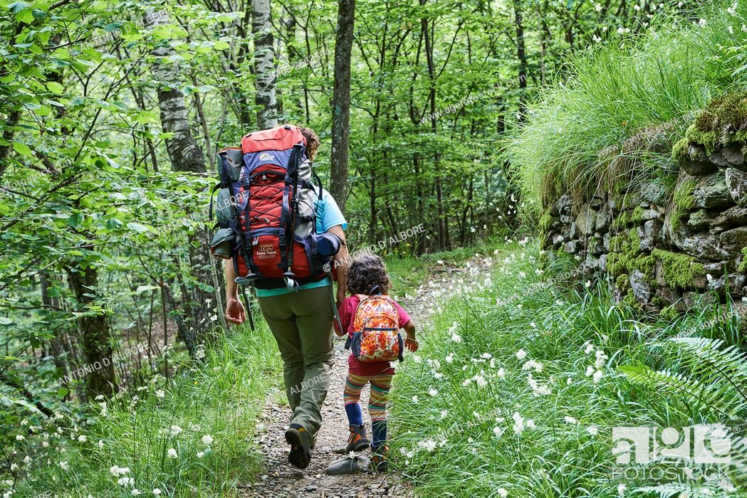 Stock Photo: Mother and daughter hiking in the forest.