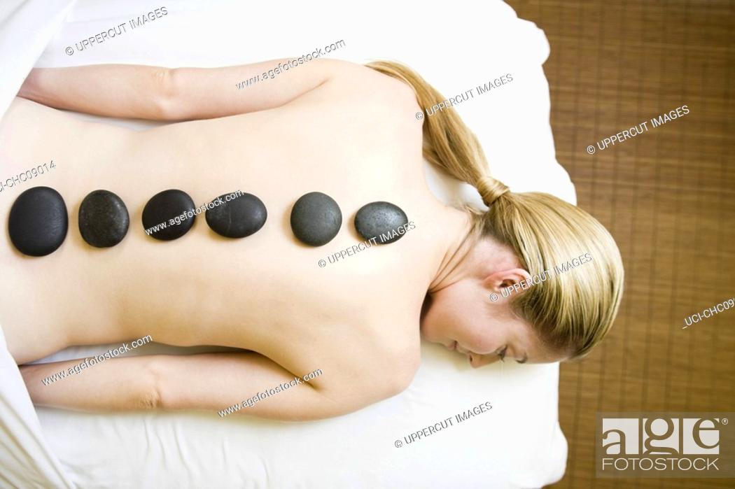 Stock Photo: Woman receiving spa stone treatment.