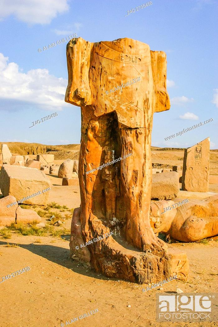 Stock Photo: Egypt, Nile Delta, Tanis, exhibition of several ancient artifacts : King colossus, with a small queen at his feet.