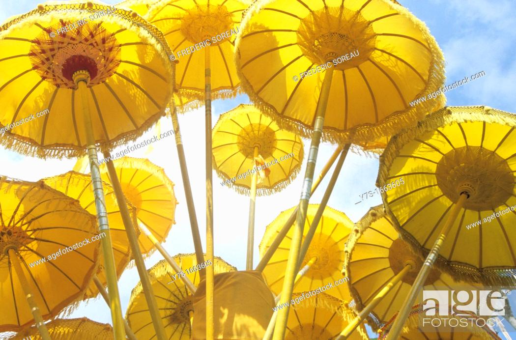 Stock Photo: Asia,South East Asia,Indonesia,yellow balinese umbrella.