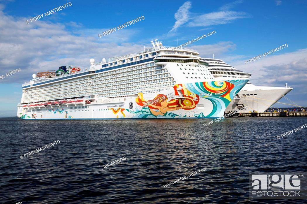 Stock Photo: Norwegian Getaway and MSC Fantasia cruise ships moored in the port of Tallinn, Estonia.