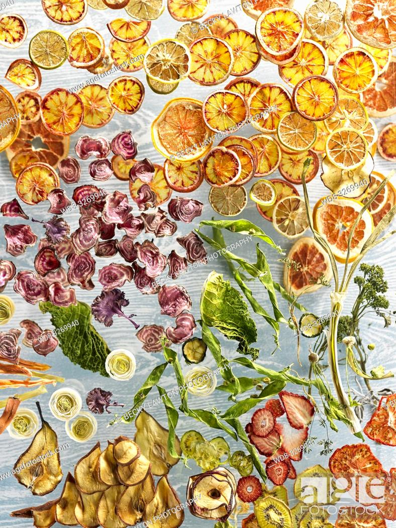 Stock Photo: Composition with dried fruits and vegetables, flying over bluish gray background.