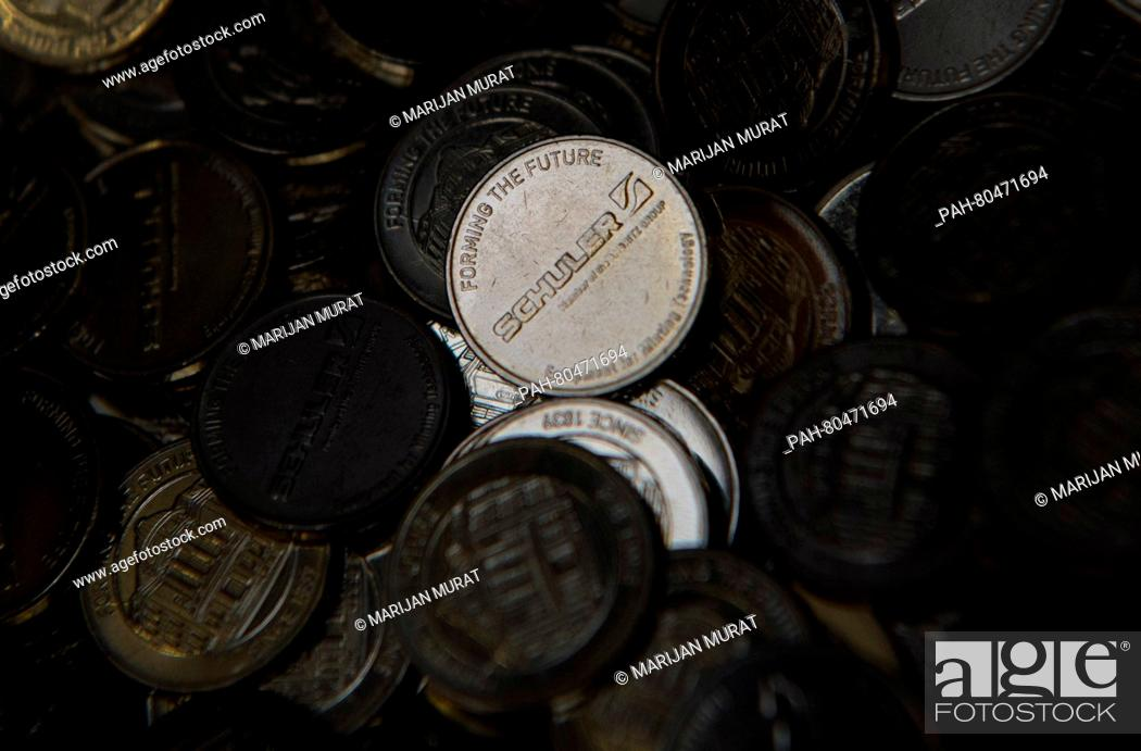A Schuler coin in a container during a press tour at the works in