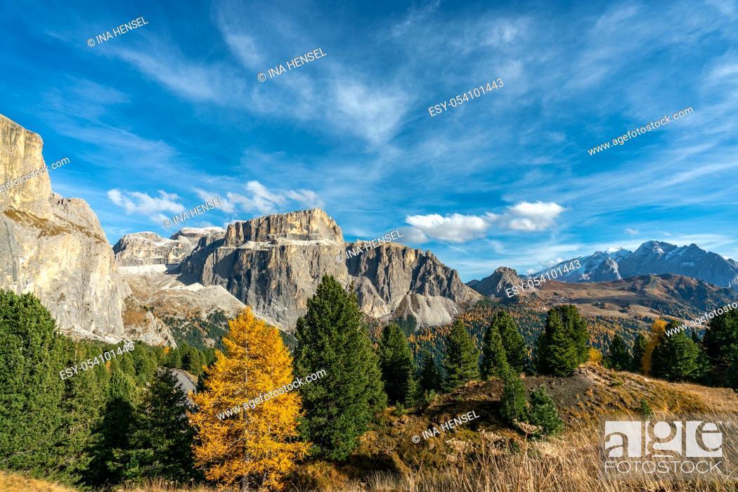 Stock Photo: The Sass Pordoi mountain of the Sella massif on a bright autumn day with yellow coloured trees in the italian Dolomites.
