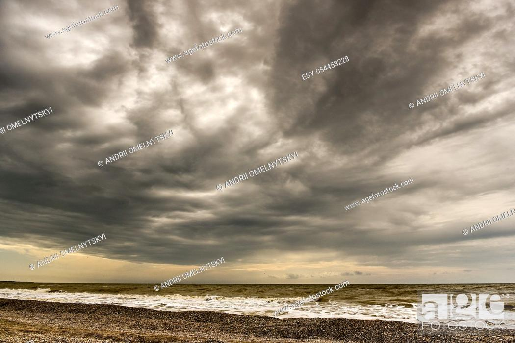 Stock Photo: the coastline of seashells on a background of sea and blue sky.