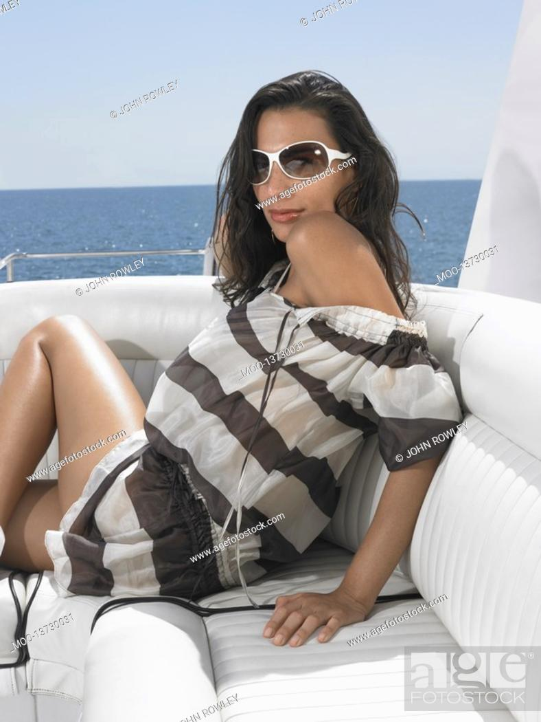 Stock Photo: Young woman on yacht portrait.