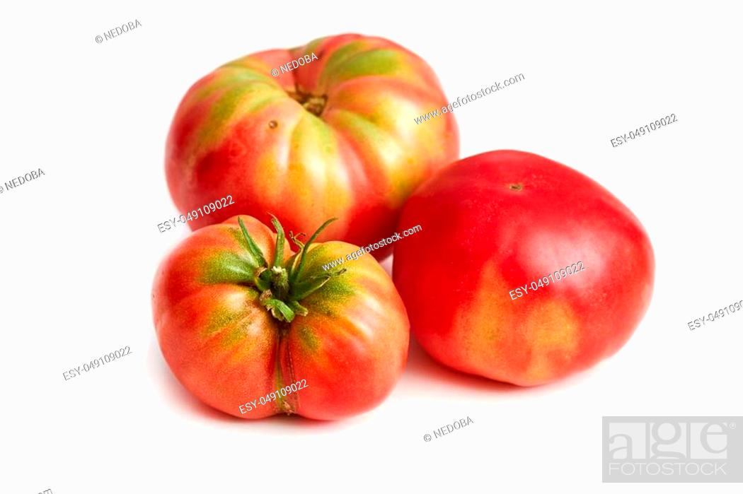 Photo de stock: Imperfect heirloom organic tomatoes isolated on white background.