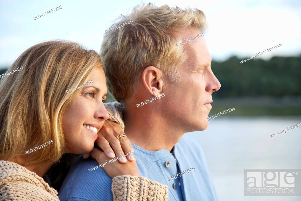 Stock Photo: Couple looking into distance.