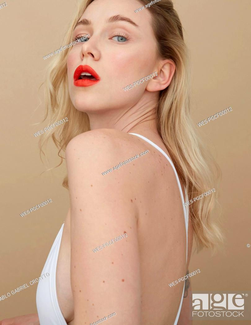 Stock Photo: Portrait of blond young woman with red lips.