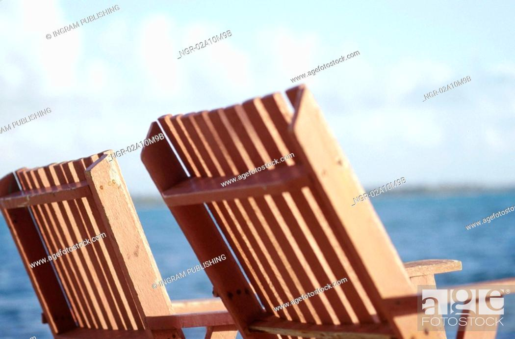 Stock Photo: Wooden Chairs by the Ocean.