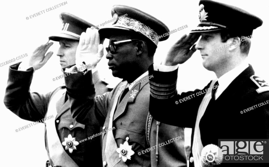 Stock Photo: Congolese President Joseph Mobutu flanked by Belgian's King Baudouin (left) and Prince Albert. Nov. 3, 1969. It was the first official visit of a Congolese head.