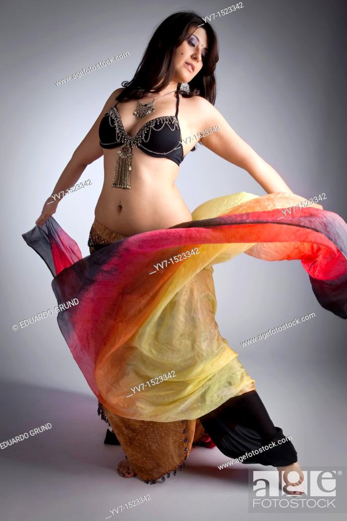 Stock Photo: Beautifull belly dancer with veil.