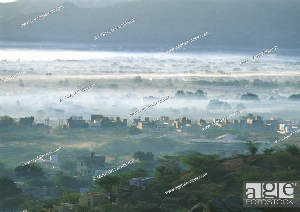 Stock Photo: India, Rajasthan, city in mist.