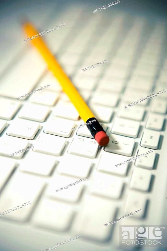 Stock Photo: pencil on keyboard.
