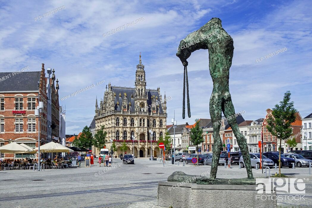 Stock Photo: Sculpture Universus by artist Johan Tahon and town hall / city hall of Oudenaarde in Flamboyant Gothic style, East Flanders, Belgium.