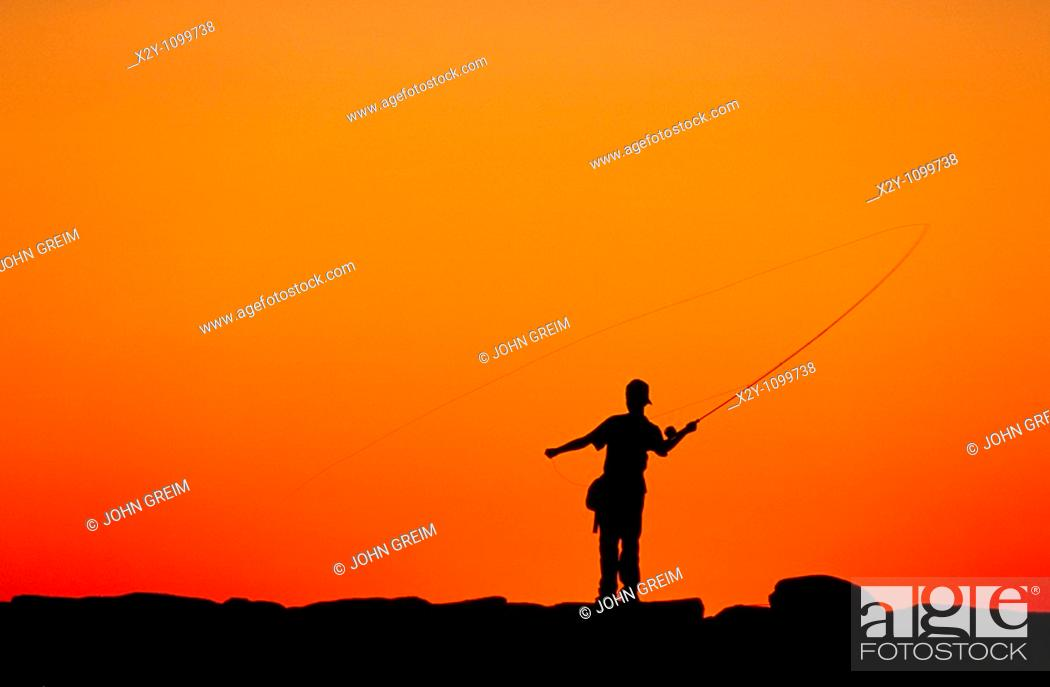 Stock Photo: Boy fishing from a jetty at sunset, Menemsha, Martha's Vineyard.