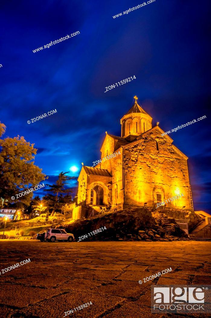 Stock Photo: Illuminated Metekhi st Virgin Church, Tbilisi old town, Georgia.