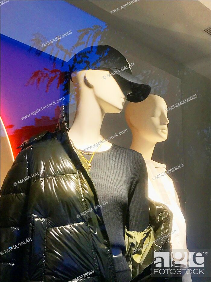 Stock Photo: Two mannequins in a shop window.