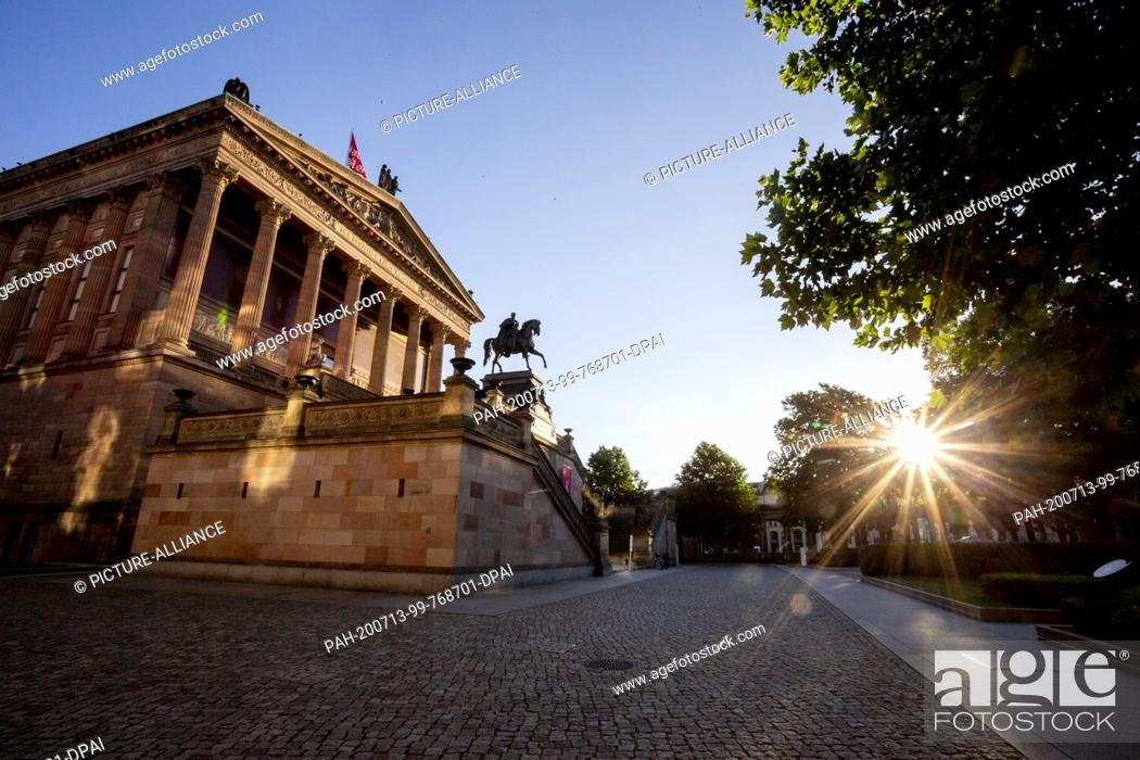 Stock Photo: 13 July 2020, Berlin: The Alte Nationalgalerie can be seen in the light of the rising sun. At a press conference today, after two years of evaluation of the.