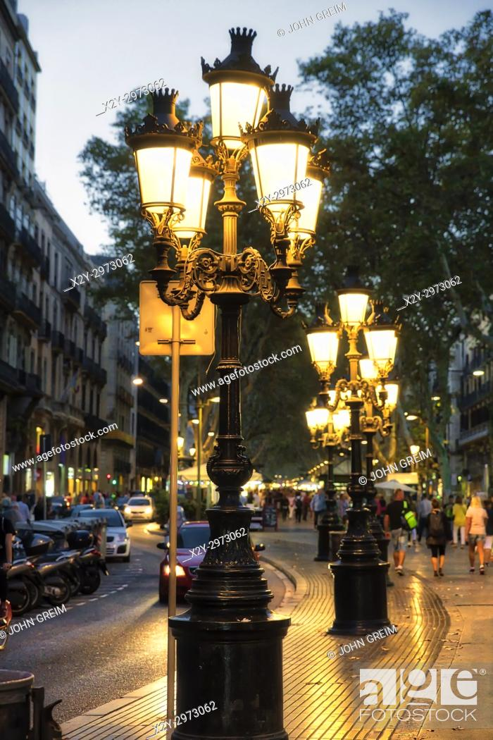 Stock Photo: Ornate street lamps adorn Las Ramblas pedestrian street, Barcelona, Spain.